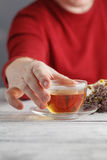 Male hands holding cup with hot herbal tea. Winter and Christmas Royalty Free Stock Image
