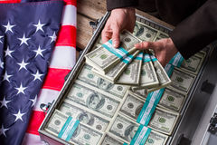 Male hands holding dollar bundles. Hands, money and american flag. Wealth and power. Income of successful politician Stock Photos