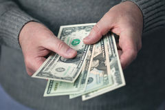 Male hands holding dollars Royalty Free Stock Image