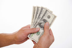 Male hands holding dollars. White background royalty free stock images