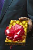Male hands holding gift. Stock Photo