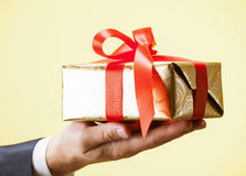 Male hands holding a gift Royalty Free Stock Images