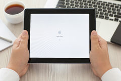 Male hands holding iPad with app Apple Store on screen Stock Images
