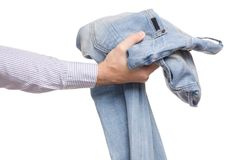 Male hands holding jeans on hands. Isolated on white background isolation Royalty Free Stock Images