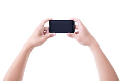 Male hands holding mobile smart phone with blank screen isolated Royalty Free Stock Photo