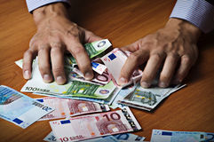 Male hands holding money Stock Image