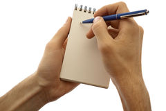 Male hands holding pad and pen isolated on a white. The man wrote in his notebook, keeping it in his hands. Close-up on a white background stock photos