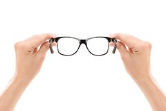 Male hands holding a pair of glasses Stock Image