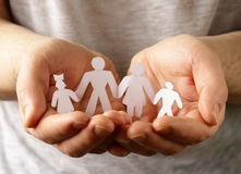 Male hands holding a paper  family Royalty Free Stock Image