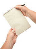 Male Hands Holding Pen and Pad of Paper Stock Photography