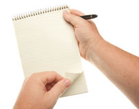 Male Hands Holding Pen and Pad of Paper Royalty Free Stock Images