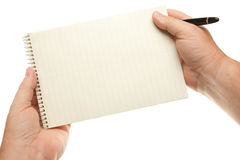 Male Hands Holding Pen and Pad of Paper Stock Image