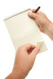 Male Hands Holding Pen and Pad of Paper stock images