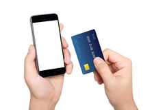 Male hands holding phone with isolated screen and credit card Stock Images