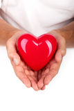 Male hands holding red heart Stock Images