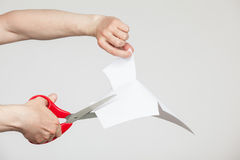 Male hands holding scissors and cutting paper Stock Photos