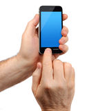 Male hands holding smartphone Stock Image
