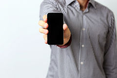 Male hands holding smartphone Stock Photo