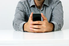 Male hands holding smartphone Royalty Free Stock Photo