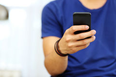 Male hands holding smartphone Stock Photos