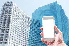 Male hands holding smartphone with modern building city backgrou Royalty Free Stock Photography