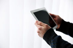 Male hands holding tablet computer Royalty Free Stock Images
