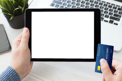 Male hands holding tablet computer with screen laptop p royalty free stock photo
