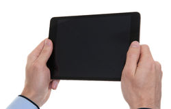 Male hands holding a tablet computer Stock Photo