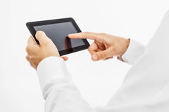Male hands holding a tablet PC royalty free stock image