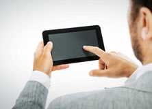 Male hands holding a tablet PC -including clipping path Royalty Free Stock Photo