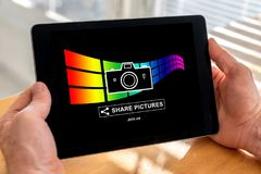 Pictures sharing concept on a tablet Royalty Free Stock Image