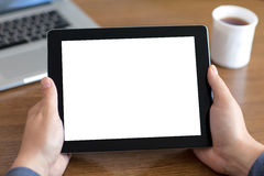 Male hands holding a tablet with  screen against the bac Stock Photo