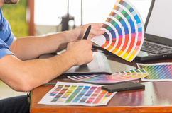 Male hands holding up pantone palette, colormap Stock Photography