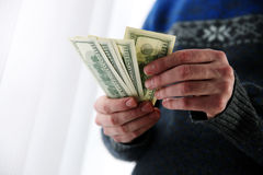 Male hands holding US dollars Stock Images