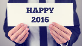 Male hands holding a white banner with Happy 2016 sign Royalty Free Stock Images