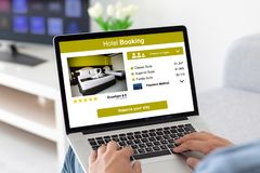 Male hands on keyboard laptop with app hotel booking. On the screen in the house in room royalty free stock photos