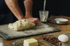 Male hands knead dough for cooking cross buns. Male hands knead the dough for cooking cross buns Royalty Free Stock Photography