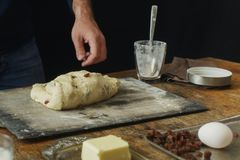 Male hands knead dough for cooking homemade cross buns. Male hands knead the dough for cooking homemade cross buns Royalty Free Stock Image