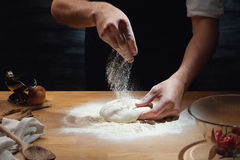 Male hands kneading dough Royalty Free Stock Photo