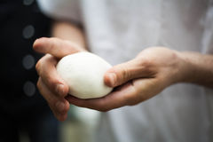 Male hands kneading dough Royalty Free Stock Images