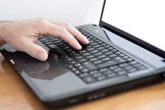 Male hands at laptop keyboard Stock Photography