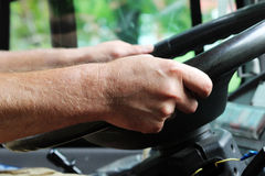 Male hands of a large bus driver long haul. Male hands of a large bus driver long haul Stock Photography