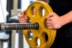 Male hands lifting heavy  barbell at gym Stock Photography