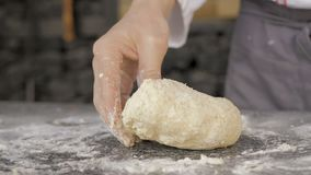 Male hands making dough for pizza stock video footage