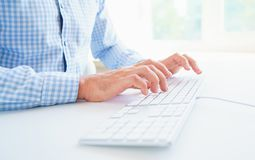 Men office worker typing on the keyboard. Male hands or man office worker typing on the keyboard Stock Photos