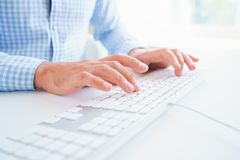 Men office worker typing on the keyboard. Male hands or man office worker typing on the keyboard Stock Photo