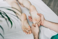 therapist do a woman foot massage. royalty free stock photo
