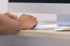 Male hands or men office worker typing on the keyboard.  Royalty Free Stock Images