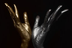 Male hands with metallic make-up Stock Photo