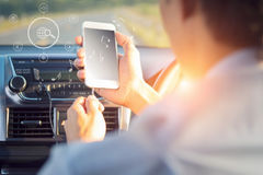 Male hands with musical note icon on smartphone screen in car. Close up of male hands with musical note icon on smartphone screen in car Royalty Free Stock Image